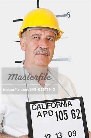 Mug shot of senior male constructor looking away Stock Photo - Premium Royalty-Free, Image code: 693-06378943