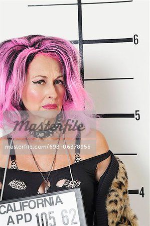 Mug shot of senior punk woman Stock Photo - Premium Royalty-Free, Image code: 693-06378955