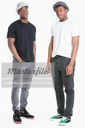 Portrait of two young African American men in casuals over gray background Stock Photo - Premium Royalty-Free, Image code: 693-06379526