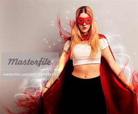 Portrait of a young woman dressed as superhero Stock Photo - Premium Royalty-Free, Image code: 693-06403193
