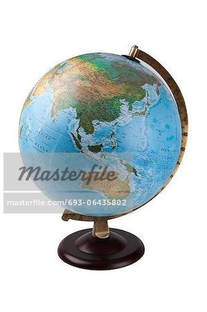 Close-up of globe over white background Stock Photo - Premium Royalty-Free, Image code: 693-06435802