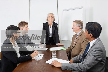 Multiethnic businesspeople at meeting in conference room Stock Photo - Premium Royalty-Free, Image code: 693-06497664