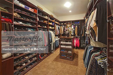 Walk in closet with organized clothing Stock Photo - Premium Royalty-Free, Image code: 693-06667907