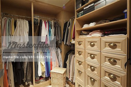 Walk in closet with organized clothing Stock Photo - Premium Royalty-Free, Image code: 693-06667915