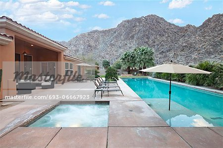 Rear view of luxury villa with swimming pool Stock Photo - Premium Royalty-Free, Image code: 693-06667923
