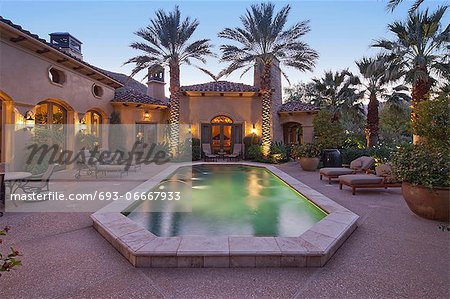 Rear entrance  of luxury villa at night with swimming pool Stock Photo - Premium Royalty-Free, Image code: 693-06667933