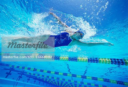 Female swimmer wearing United States swimsuit while swimming in pool Stock Photo - Premium Royalty-Free, Image code: 693-06668082