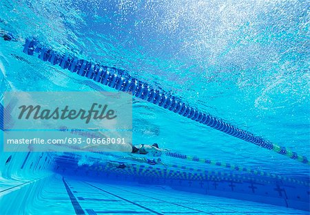 Swimmers racing together in swimming pool Stock Photo - Premium Royalty-Free, Image code: 693-06668091