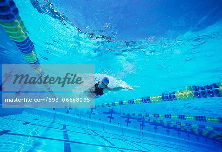 Young female swimmer in competition Stock Photo - Premium Royalty-Free, Image code: 693-06668095
