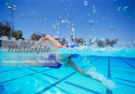 Female swimmer in United States swimsuit swimming in pool Stock Photo - Premium Royalty-Free, Image code: 693-06668098