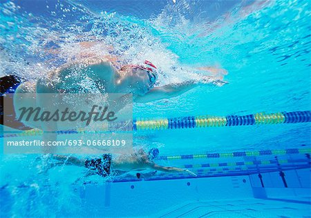 Underwater shot of three male athletes in swimming competition Stock Photo - Premium Royalty-Free, Image code: 693-06668109