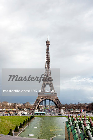 Eiffel Tower viewed from Champ de Mars Paris France Stock Photo - Premium Royalty-Free, Image code: 693-06967300
