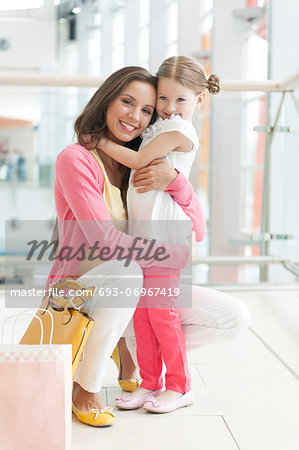Mother and daughter hugging Stock Photo - Premium Royalty-Free, Image code: 693-06967419