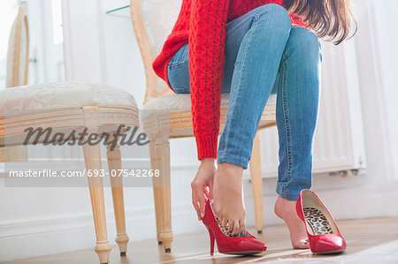 Low section of woman trying on footwear in store Stock Photo - Premium Royalty-Free, Image code: 693-07542268