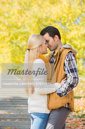 Couple kissing in park during autumn Stock Photo - Premium Royalty-Free, Image code: 693-07672895