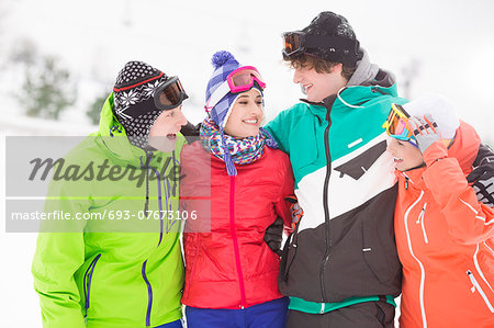 Portrait of young friends standing together in snow Stock Photo - Premium Royalty-Free, Image code: 693-07673106