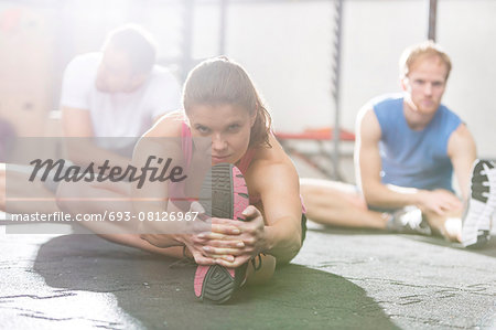 Portrait of confident woman exercising in crossfit gym Stock Photo - Premium Royalty-Free, Image code: 693-08126967