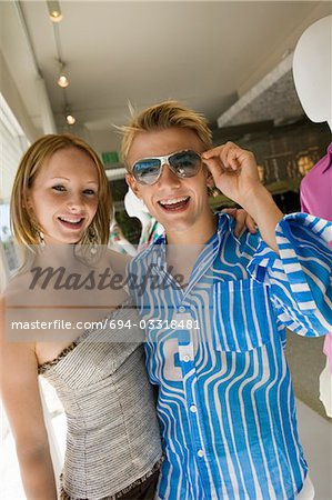 Young Couple Shopping in clothing store Together, portrait Stock Photo - Premium Royalty-Free, Image code: 694-03318481