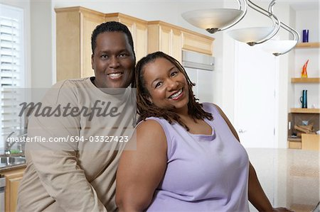 Couple in kitchen, portrait Stock Photo - Premium Royalty-Free, Image code: 694-03327423