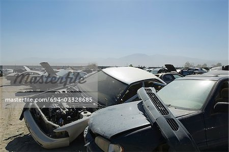 Cars in junkyard Stock Photo - Premium Royalty-Free, Image code: 694-03328685