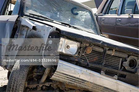 Damaged car in junkyard Stock Photo - Premium Royalty-Free, Image code: 694-03328696