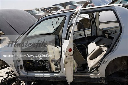 Damaged car in junkyard Stock Photo - Premium Royalty-Free, Image code: 694-03328699