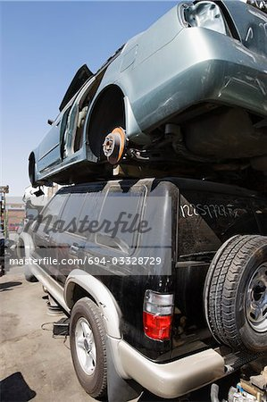 Cars in junkyard Stock Photo - Premium Royalty-Free, Image code: 694-03328729