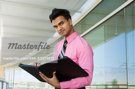 Businessman Writing in a Planner Stock Photo - Premium Royalty-Free, Image code: 694-03329872