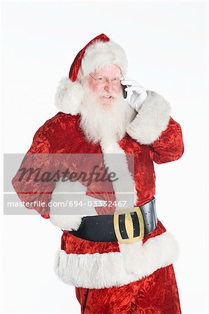 Santa Claus on mobile phone Stock Photo - Premium Royalty-Free, Image code: 694-03332467