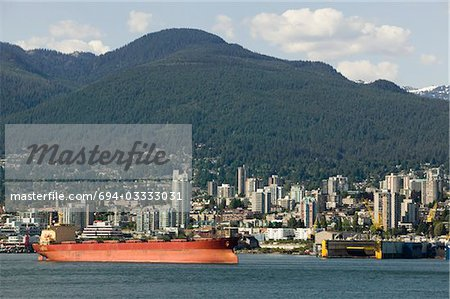 Cargo ship in Vancouver Harbour, British Columbia Stock Photo - Premium Royalty-Free, Image code: 694-03333031