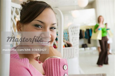 Girl Hanging Out in Boutique, portrait, close up Stock Photo - Premium Royalty-Free, Image code: 694-03692427