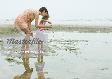 Mother and daughter on beach, full length Stock Photo - Premium Royalty-Free, Image code: 695-03373517