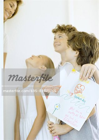 Children giving woman mother's day surprise Stock Photo - Premium Royalty-Free, Image code: 695-03373765