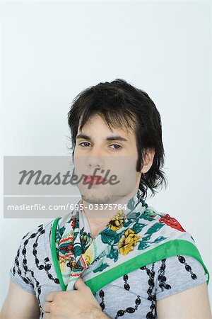 Young man wearing lipstick and scarf around neck, portrait Stock Photo - Premium Royalty-Free, Image code: 695-03375784