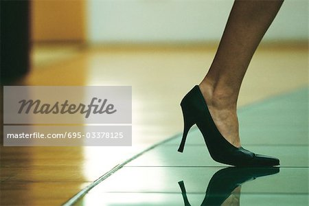 Woman walking in high heels, cropped view of foot Stock Photo - Premium Royalty-Free, Image code: 695-03378125