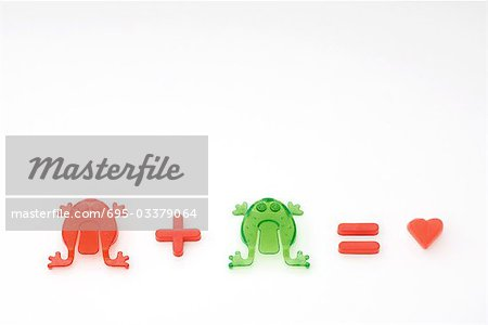 Green frog plus red frog equals love Stock Photo - Premium Royalty-Free, Image code: 695-03379064