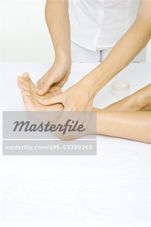Woman receiving foot massage, cropped view Stock Photo - Premium Royalty-Free, Image code: 695-03380205