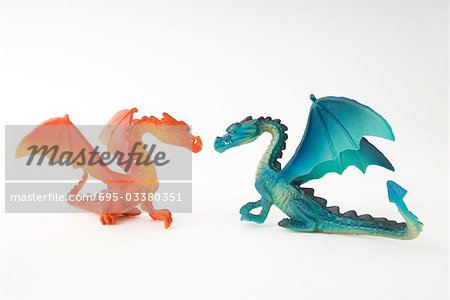 Toy dragons face to face, side view Stock Photo - Premium Royalty-Free, Image code: 695-03380351