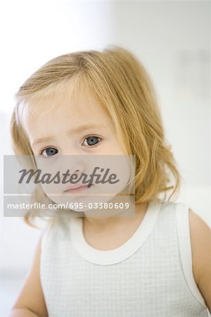 Toddler girl looking at camera, portrait Stock Photo - Premium Royalty-Free, Image code: 695-03380609