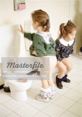 Two little girls using children's toilets Stock Photo - Premium Royalty-Free, Image code: 695-03381153