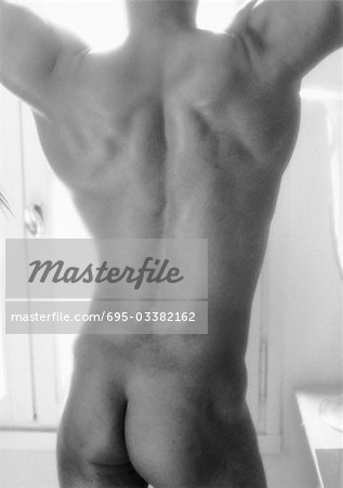 Nude man, mid section, rear view, b&w Stock Photo - Premium Royalty-Free, Image code: 695-03382162