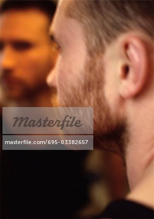 Man's face, view from over the shoulder, man's reflection in mirror in background Stock Photo - Premium Royalty-Free, Image code: 695-03382657