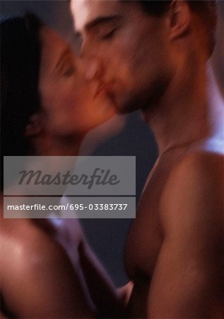 Nude man and woman kissing, blurred, close-up Stock Photo - Premium Royalty-Free, Image code: 695-03383737