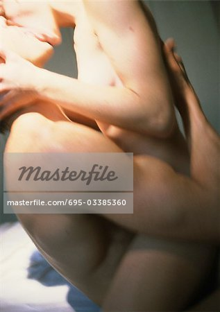Nude couple making love, side view, close-up Stock Photo - Premium Royalty-Free, Image code: 695-03385360