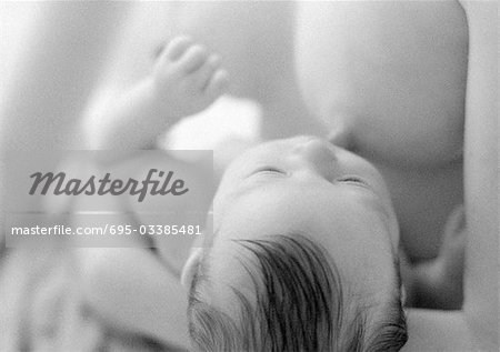 Infant breastfeeding, b&w Stock Photo - Premium Royalty-Free, Image code: 695-03385481
