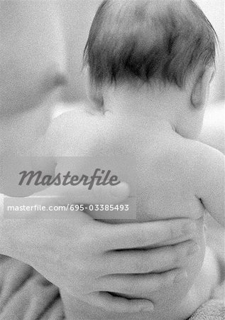 Mother's hand on infant's back, b&w Stock Photo - Premium Royalty-Free, Image code: 695-03385493