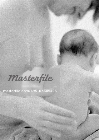 Nude mother patting infant on back, b&w Stock Photo - Premium Royalty-Free, Image code: 695-03385495