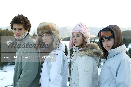 Young friends standing in snowy landscape, portrait Stock Photo - Premium Royalty-Free, Image code: 695-03389263