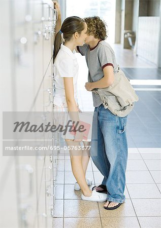 Teen couple leaning against school lockers Stock Photo - Premium Royalty-Free, Image code: 695-05763377