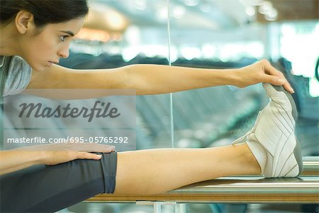 Woman stretching leg on barre Stock Photo - Premium Royalty-Free, Image code: 695-05765292